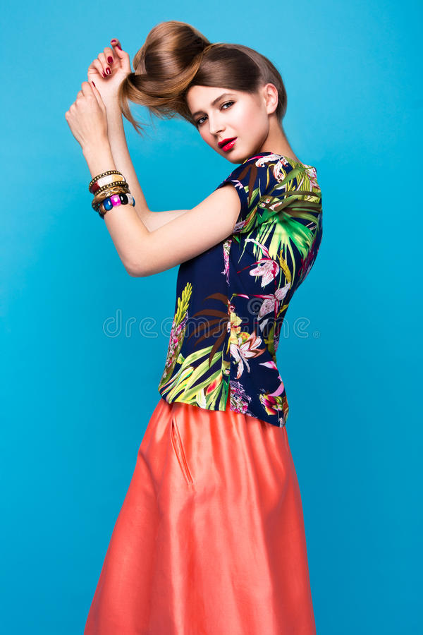 Beautiful fashionable woman an unusual hairstyle in bright clothes and colorful accessories. Cuban style. royalty free stock image