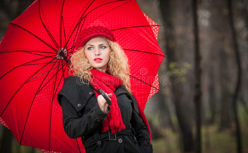Download Beautiful Fashionable Young Girl With Red Umbrella , Red Cap And Red Scarf In The Park Stock Photo - Image: 34367062