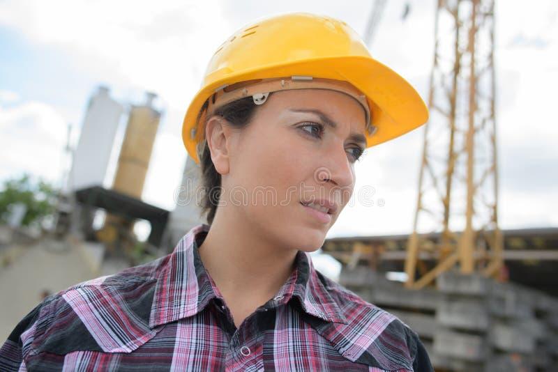 Beautiful female architect at construction site stock photo