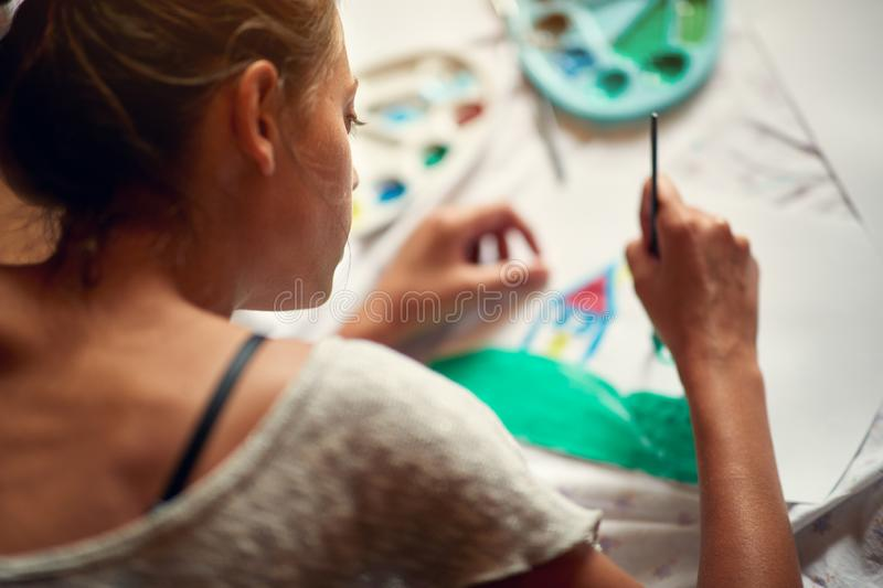 Female artist painting stock images