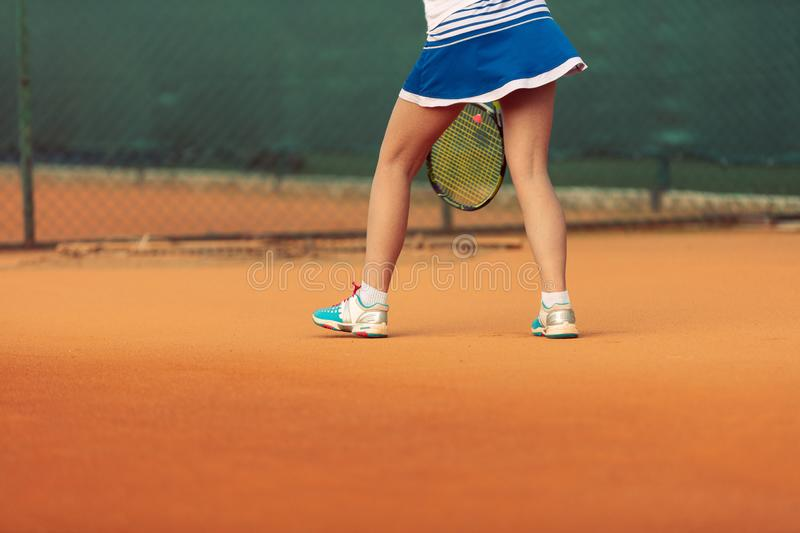 Beautiful female athlete with perfect body posing on tennis court, close up stock photos