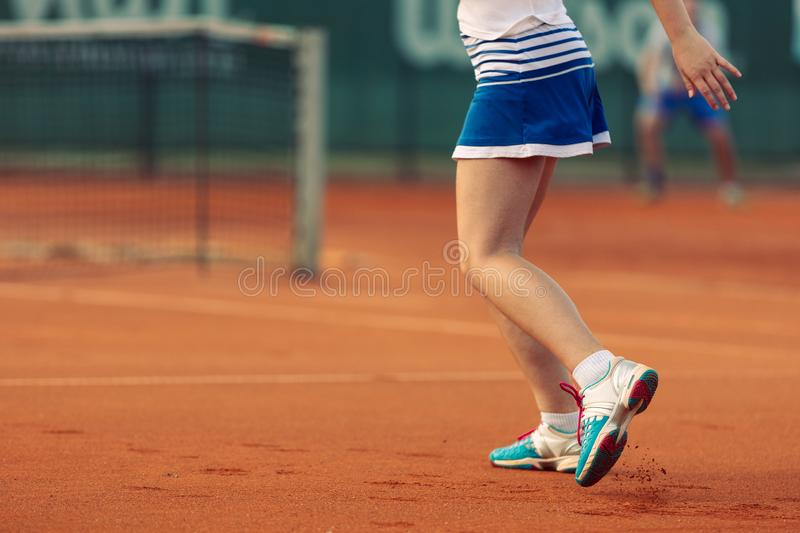 Beautiful female athlete with perfect body posing on tennis court, close up stock photo