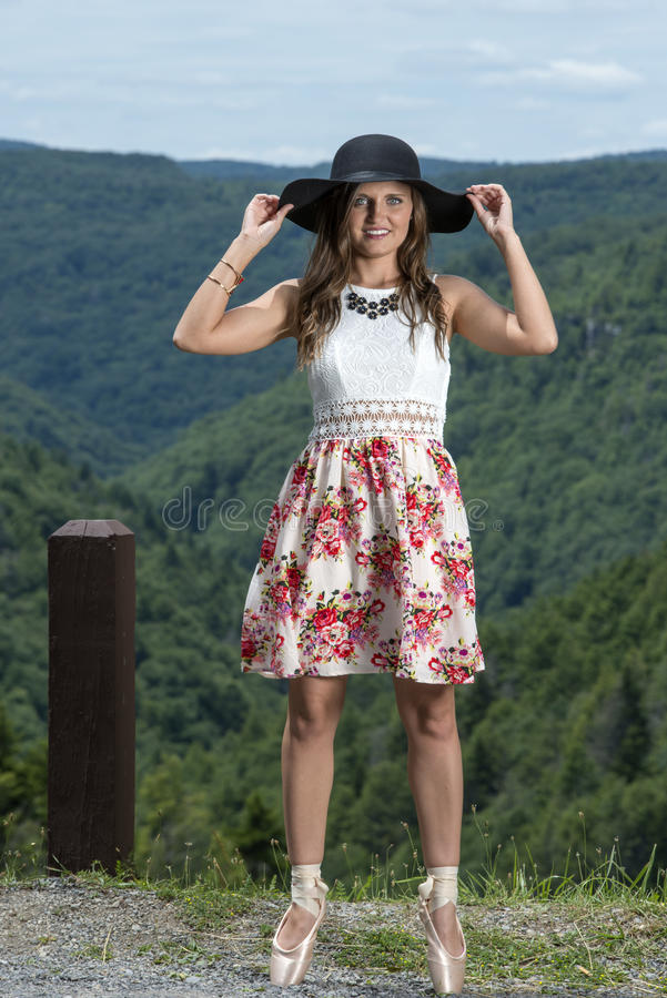 Beautiful female ballerina or dancer stands en pointe stock image