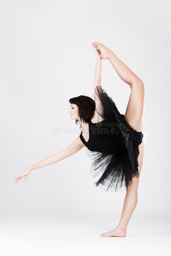 Beautiful Female Ballerina Doing Split Stock Images
