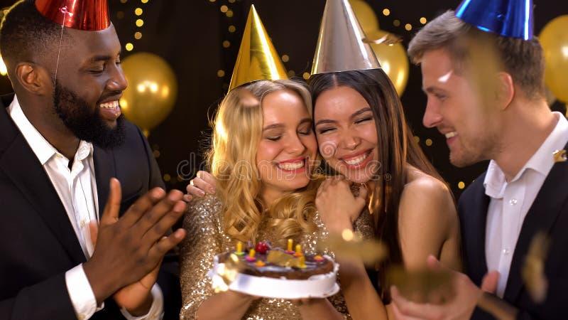 Beautiful female celebrating birthday, holding cake, friends congratulations royalty free stock photo