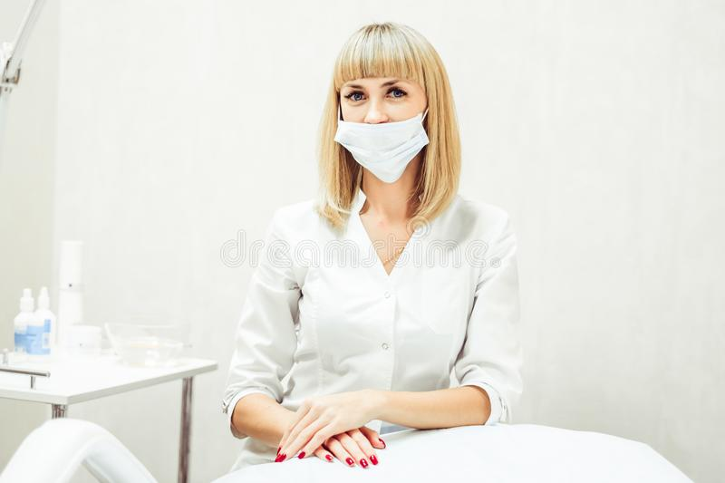 A woman in a lab coat stock photos