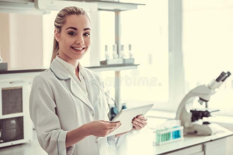 Beautiful female doctor in laboratory royalty free stock photo