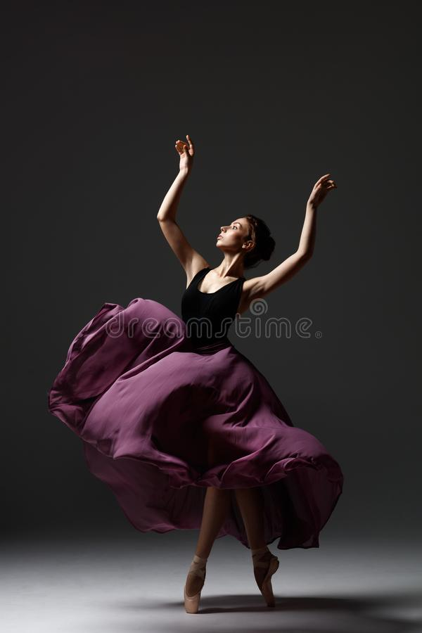 Young beautiful ballerina is posing in studio royalty free stock images
