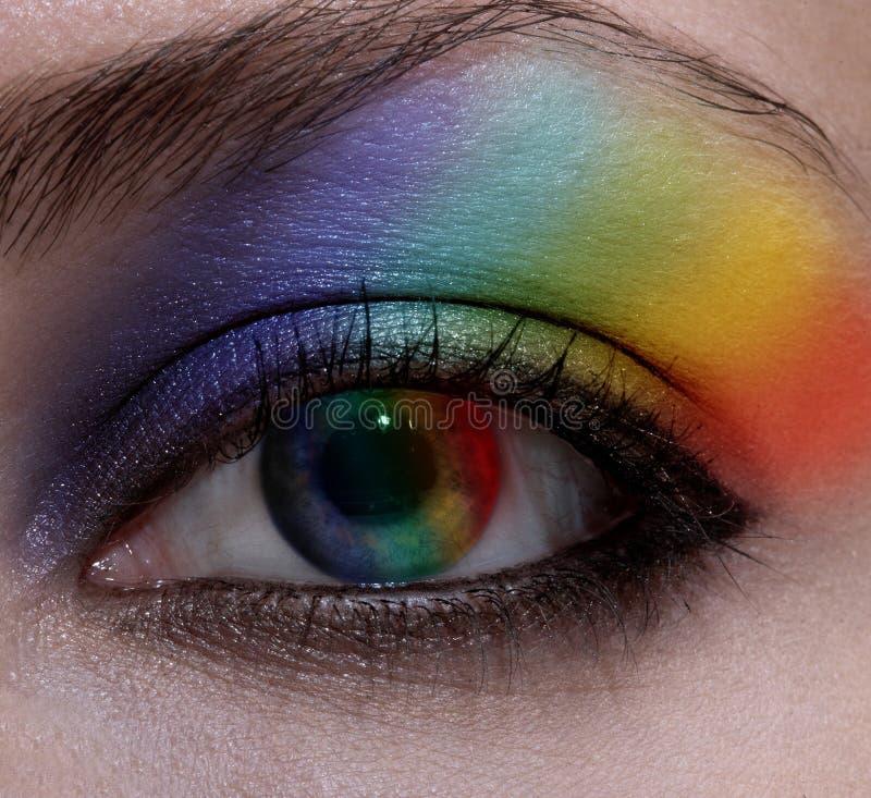Beautiful female eye. With make-up rainbow stock photo