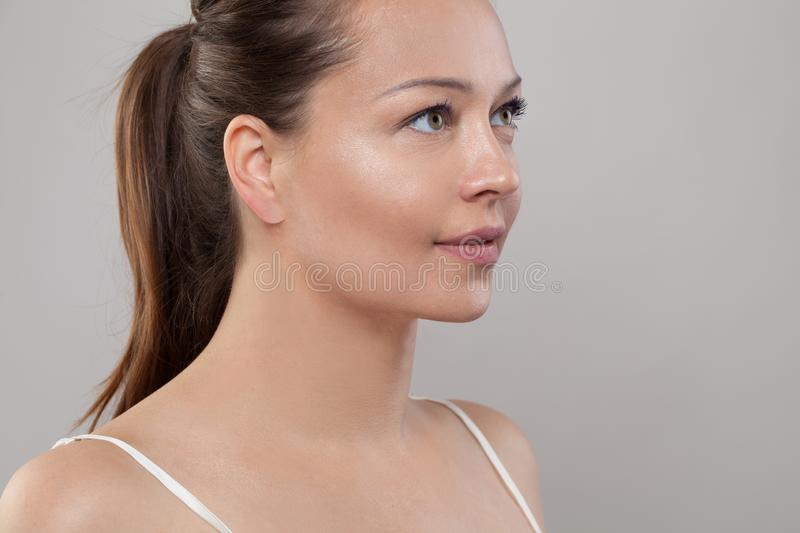 Beautiful female face. Healthy model with clear skin. Skincare and facial treatment concept. Beautiful female face closeup. Healthy model with perfect natural stock photos