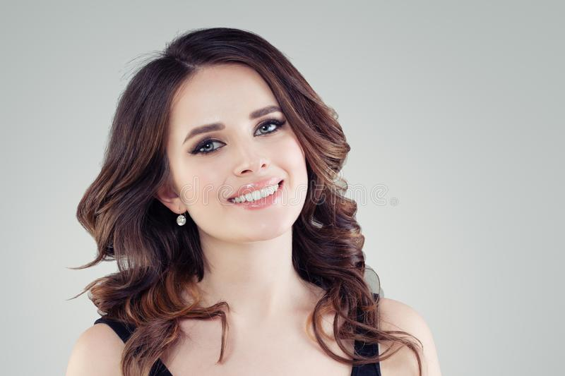 Beautiful female face closeup. Smiling young woman portrait royalty free stock photo