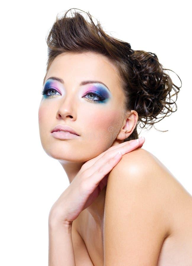 Beautiful female face with fashion makeup stock photo