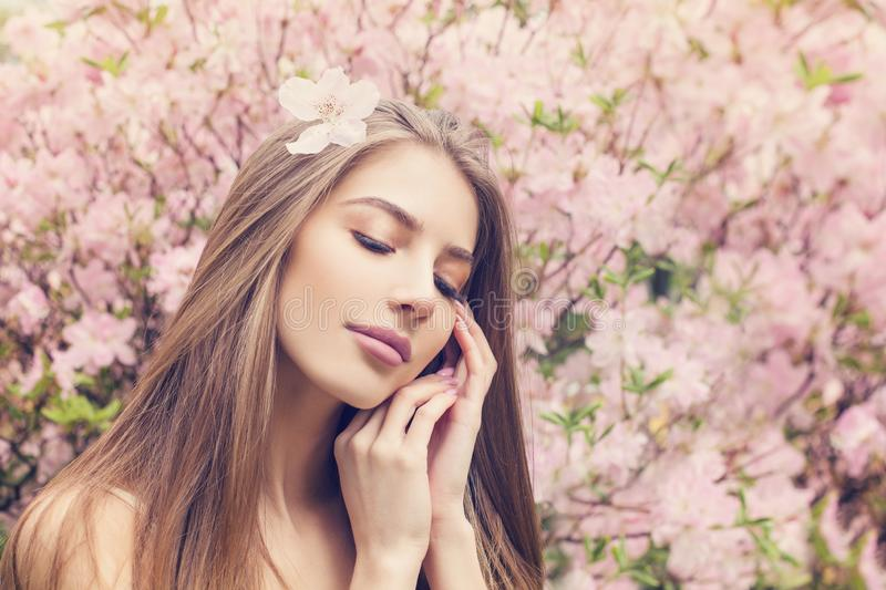 Beautiful female face. Healthy model with clear skin and perfect long straight hair. Skincare and facial treatment concept stock photography