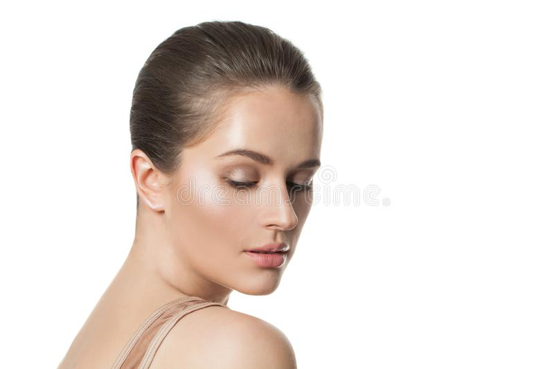 Beautiful female face isolated. Healthy model with clear skin. Skincare and facial treatment concept royalty free stock image
