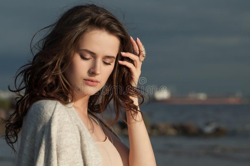 Beautiful female face outdoors portrait. Pretty woman on nature background.  royalty free stock image