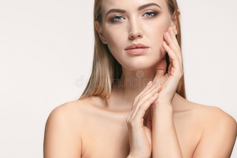 Beautiful Girl face. Perfect skin. The beautiful female face. The perfect and clean skin of face on white stock photography
