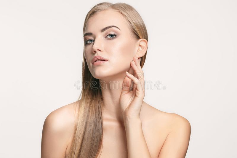 Beautiful Girl face. Perfect skin. The beautiful female face. The perfect and clean skin of face on white royalty free stock images
