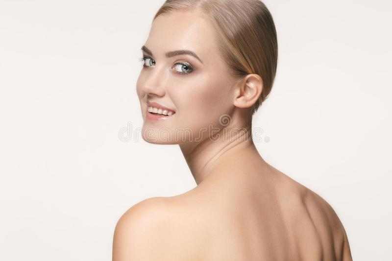 Beautiful Girl face. Perfect skin. The beautiful female face. The perfect and clean skin of face on white royalty free stock photos