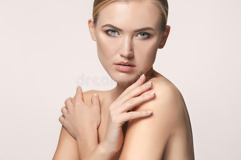 Beautiful Girl face. Perfect skin. The beautiful female face. The perfect and clean skin of face on white stock image