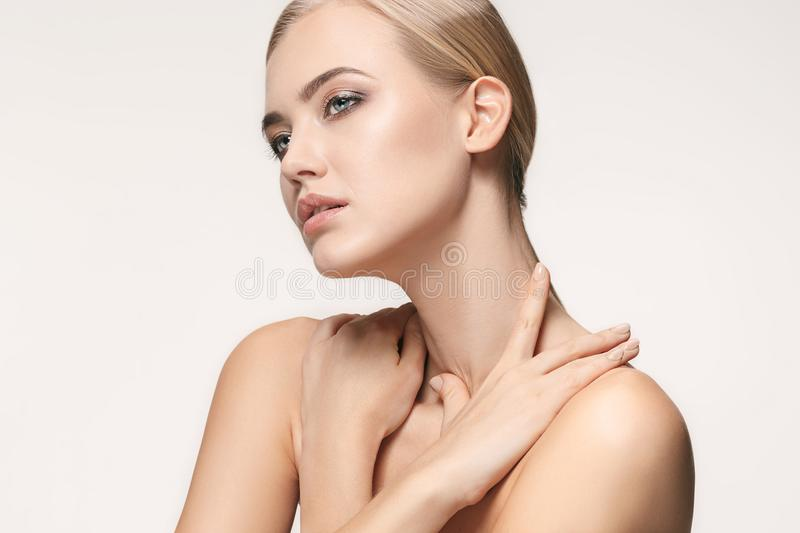 Beautiful Girl face. Perfect skin. The beautiful female face. The perfect and clean skin of face on white stock images