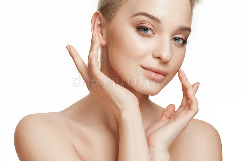 Beautiful Girl face. Perfect skin. The beautiful female face. The perfect and clean skin of face on white. The beauty, care, skin, treatment, health, spa royalty free stock photo