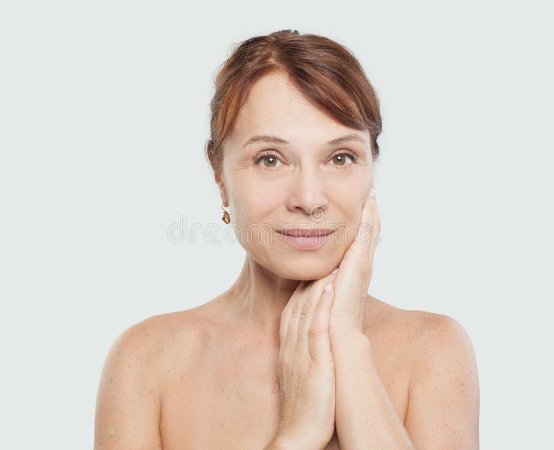 Beautiful female face on white background. Facial treatment, aesthetic medicine and plastic surgery royalty free stock photos