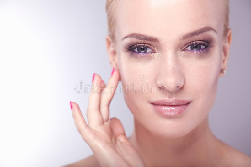 Beautiful female face. Young perfect woman closeup portrait on white background.  royalty free stock photography