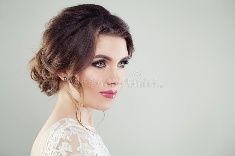 Beautiful female face. Young perfect woman with makeup and bridal hairdo, portrait royalty free stock photos
