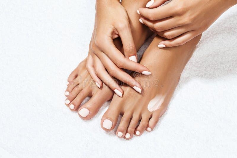 Beautiful female feet with moisturizing cream. stock photo