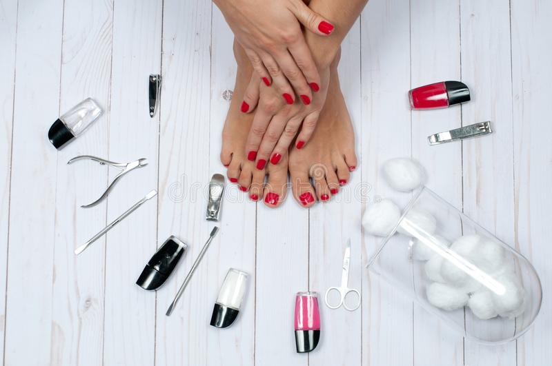 Beautiful female feet at spa salon on pedicure procedure royalty free stock images