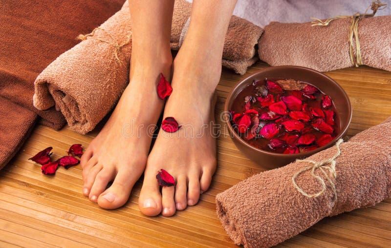 Beautiful female feet, spa salon, pedicure procedure royalty free stock photo