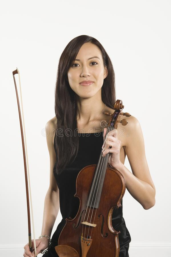 Beautiful Female With Fiddlestick And Violin. Portrait of beautiful female holding violin and fiddlestick isolated over white background stock photos
