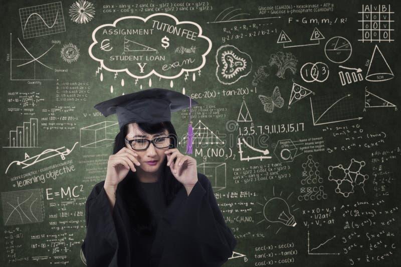 Beautiful female graduate crying in class stock photo