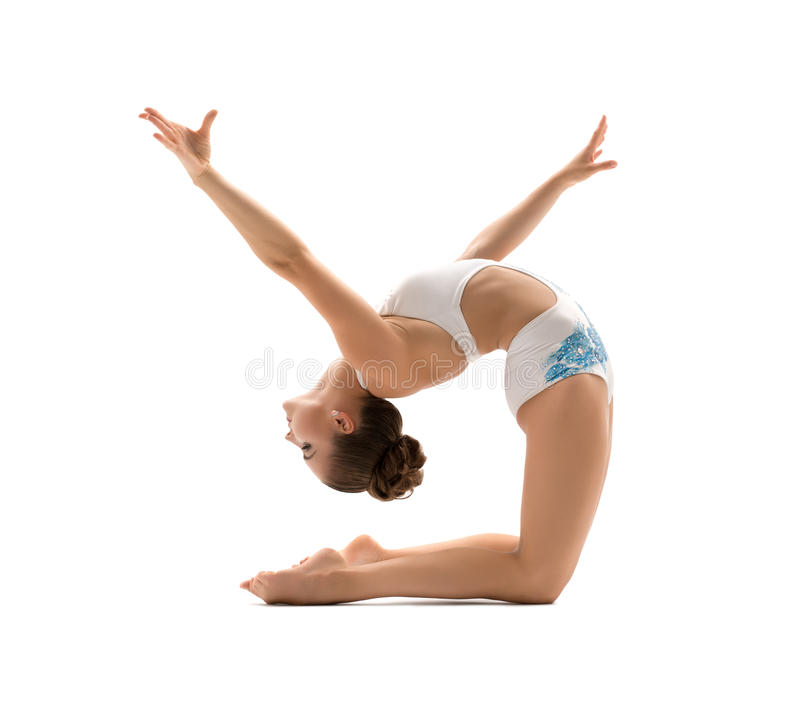 Beautiful female gymnast stretching and exercising. Beautiful female gymnast doing acrobatic exercise, isolated on white background. Young athletic woman in stock photo