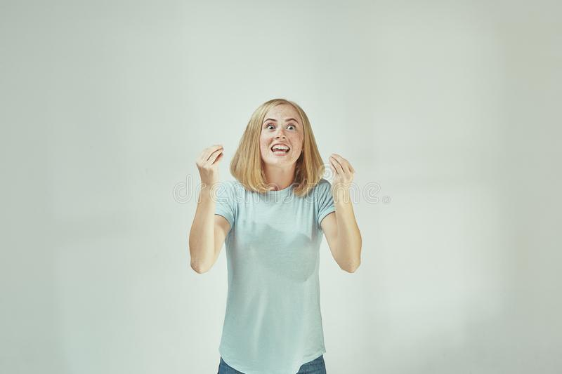Beautiful female half-length portrait isolated on gray studio backgroud. The young emotional surprised woman. Argue, arguing concept. Beautiful female half royalty free stock image