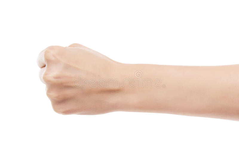 Beautiful female hand clenched fist. stock photos