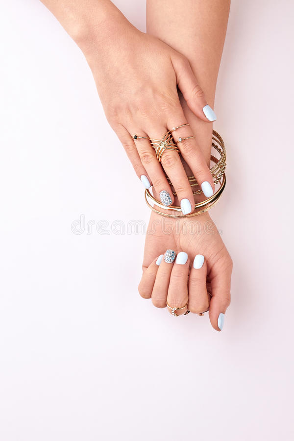 Beautiful Female Hands In Gold Bracelets And Rings. Stock Image ...