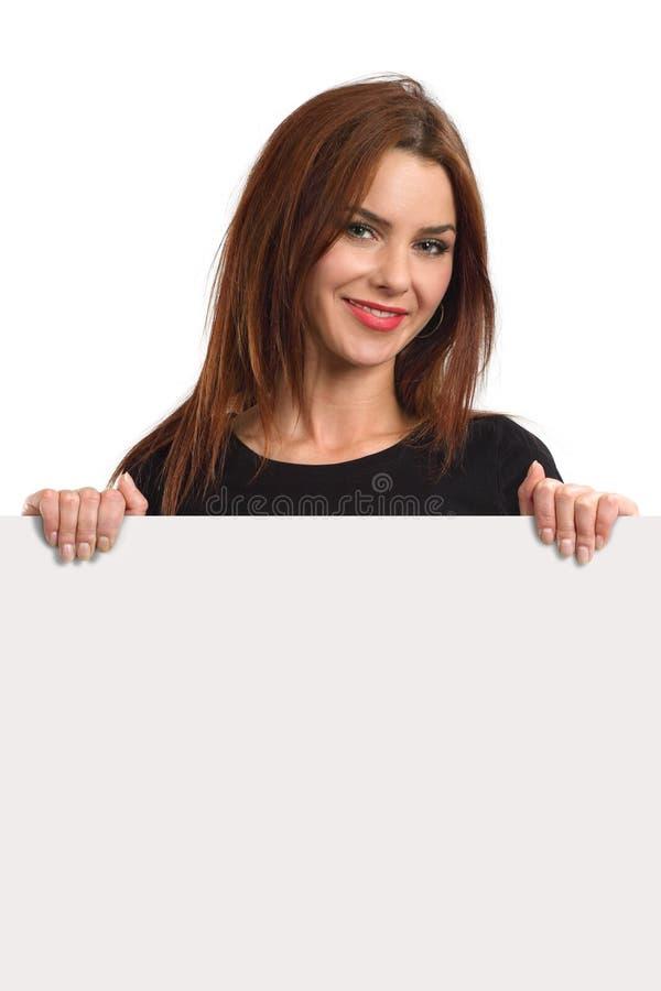 Beautiful female holding blank sign stock image