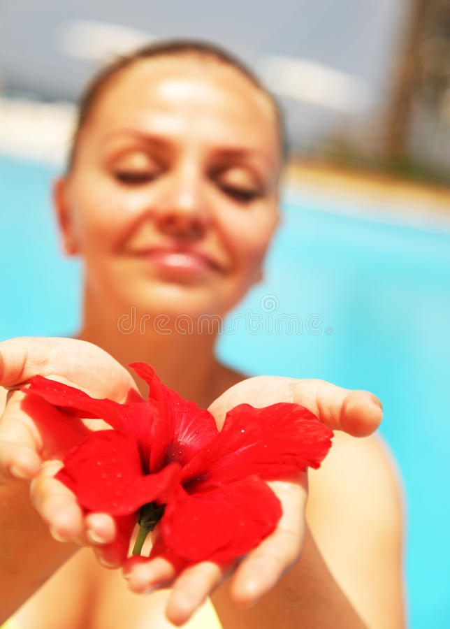 Beautiful female holding red flower royalty free stock photography