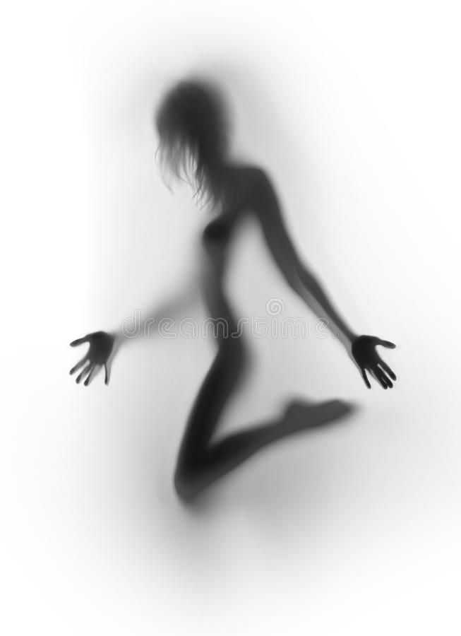 Beautiful female human body silhouette. Naked woman hands, fingers, long hair and leg royalty free stock images