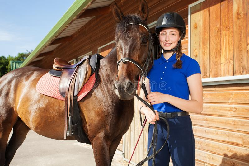 Beautiful female jockey with her purebred horse royalty free stock photos