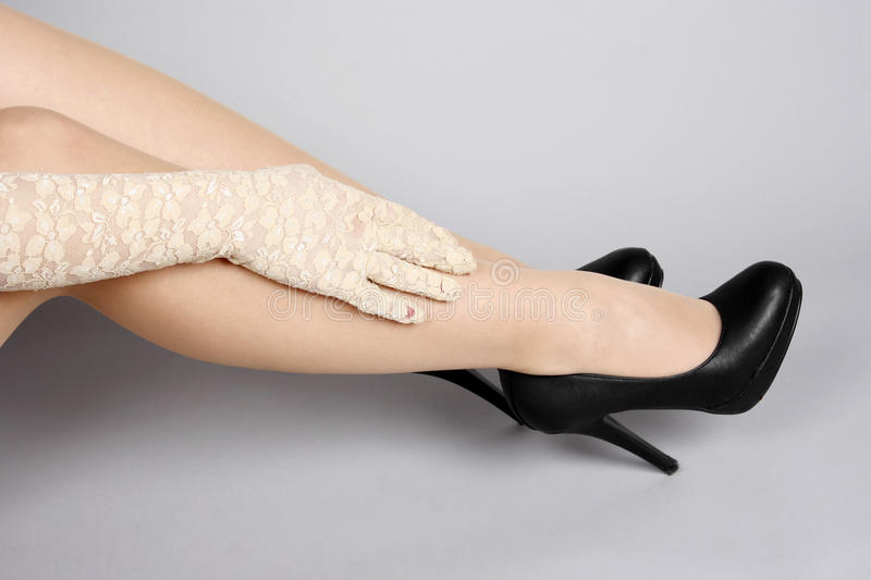 Beautiful female legs. And high heels shoes royalty free stock images