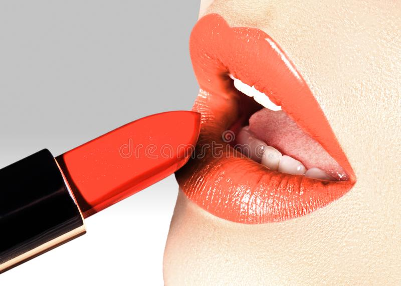 Beautiful female lips with fashion make-up. Trend light coral color. Makeup, visage and cosmetics. Choice lipstick royalty free stock image