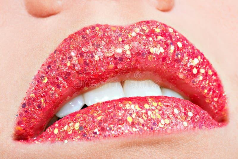Beautiful female lips with shiny red gloss lipstick. Closeup beautiful female lips with shiny red gloss lipstick royalty free stock photos