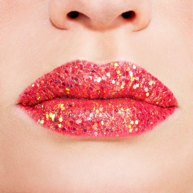 Beautiful female lips with shiny red gloss lipstick. Closeup beautiful female lips with shiny red gloss lipstick stock photos