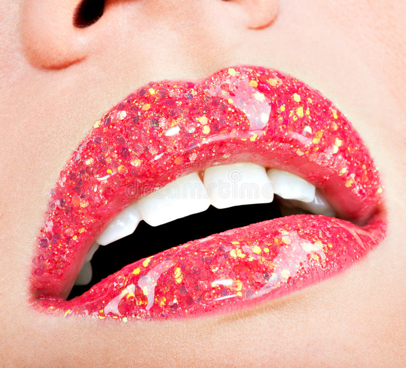 Beautiful female lips with shiny red gloss lipstick. Closeup beautiful female lips with shiny red gloss lipstick royalty free stock images