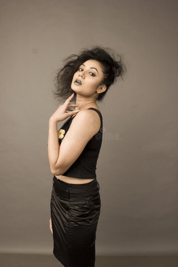 Beautiful female model in a black skirt stock photo