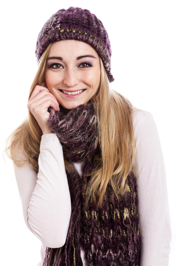 Beautiful female model wearing beanie and scarf. Beautiful female model with long blond hair smiling wearing beanie and scarf on white background stock images