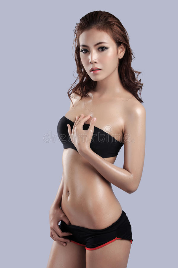 Beautiful Female Model Wearing Gray Tank Top Stock Photo