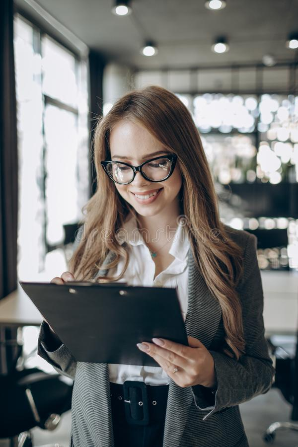 A Beautiful Female Office Employee in Glasses stock photography